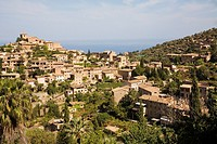 View of Deia and mediterranean sea in the background, in Serra de Tramuntana. Mallorca. Balearic Island. Spain