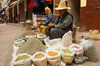 Two Moroccan men sell herbs and spices in the Old Medina, Casablanca, Morocco, Africa