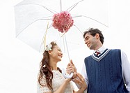 Couple open an umbrella