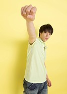 Young man raising fist