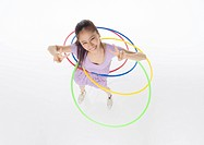 Young woman playing with hula hoops
