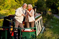 Couple drinking wine on boat in canal