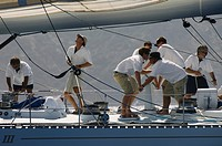 Crew working on yacht side view
