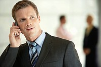 Businessman in Office Using Cell Phone close_up