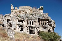 Ancient Lycian house type rock cut tombs on the Tlos acropolis  South West Turkey