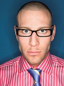 Man in glasses head and shoulders portrait