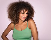 Woman with Curly Hair winking in studio half_length