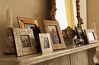 Marble Fireplace Mantel With Framed Pictures and mirror