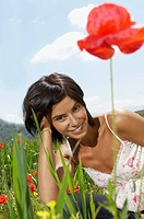 Woman Lying in flowery Meadow portrait (thumbnail)