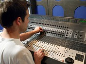Sound technician in recording studio back view