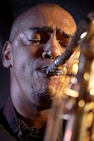 Saxophone player on stage portrait close_up