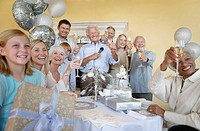 Family and friends celebrating toasting Having a Party