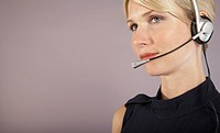 Businesswoman wearing headset close_up portrait