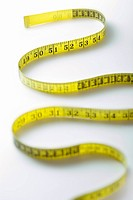 Winding strip of measuring tape close_up