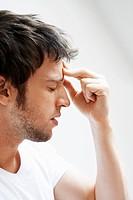 Man with Headache touching forehead