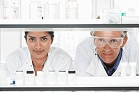 Two Lab Workers Looking Through Shelves