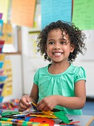 Girl assembling puzzles in classroom portrait