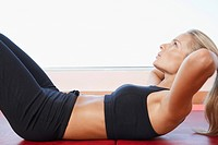 Woman Doing Sit-Ups close up side view (thumbnail)