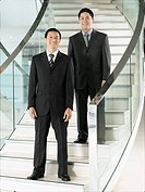 Confident Businessmen standing on staircase