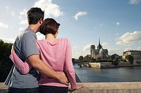 Paris France Couple embracing in front of Notre Dame Cathedral back view