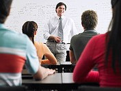 Teacher talking to students in classroom (thumbnail)