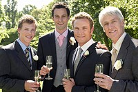 Four men toasting at wedding portrait