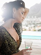 Woman with champagne glass outdoors near mountains (thumbnail)