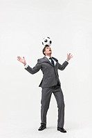 Businessman holding football over head