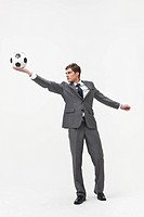 businessman holding football