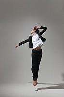 young woman dancing, studio
