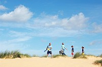 Vacationing Family walking along beach