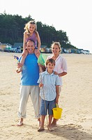 Vacationing Family standing on Beach portrait