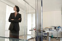 Businesswoman standing in office front view