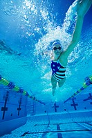 Woman swimming underwater low angle view
