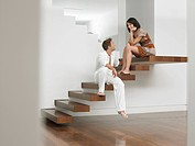 Young Couple Sitting on Stairs