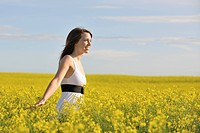 Woman in a canola field