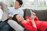 Middle_aged couple relaxing on sofa