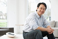 Middle_aged Asian man in living room