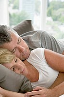 Middle_aged couple cuddling in bed
