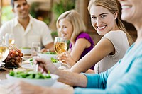 Smiling woman at a family dinner