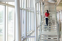Businesswoman walking down staircase