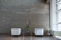 Modern armchairs in office lobby