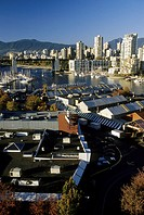 Skycrapers of downtown off of Sunset beach with buildings of Granville Island in foreground- Vancouver British Columbia, Canada