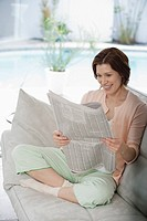 Woman reading newspaper