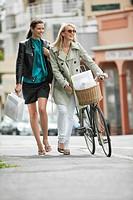 Two women walking with shopping bags
