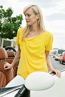 Woman standing near a car after shopping