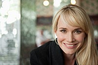 Portrait of a woman smiling in a cafe