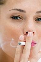 Portrait of a woman smoking a cigarette (thumbnail)