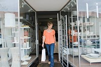 Woman coming out of a store after shopping