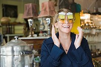 Woman wearing sunglasses in a store